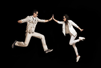 Talented couple dancing on the black background