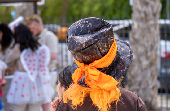 An person in a mad hatter's hat celebrate the Purim holiday