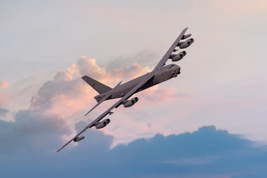Boeing B52 United states Airforce (USAF) heavy nuclear bomber turning to the camera at sunset