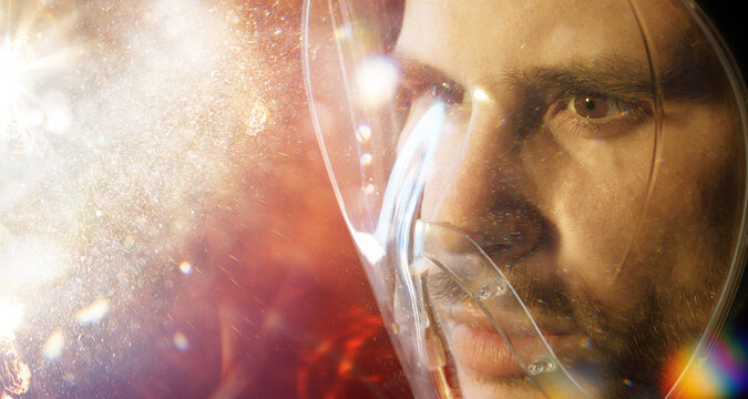 Futuristic astronaut in a spacesuit. Abstract man portrait. Digital art. Augmented reality, future technology, game concept.
