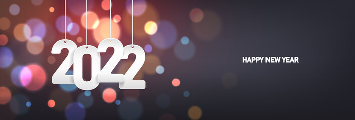 Obraz Happy new year 2022. Hanging white paper number on a horizontal colorful blurry background.  - fototapety do salonu