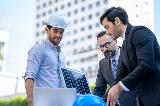 Two businessmen discuss about renewable energy solar panels on s