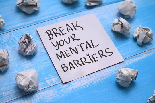 Break your mental barriers, text words typography written on book against wooden background, life and business motivational inspirational