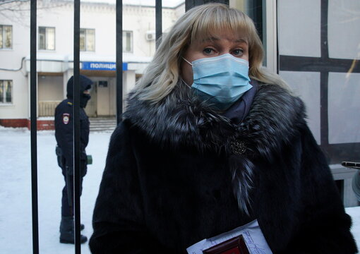 Olga Mikhailova, lawyer of Russian opposition leader Alexei Navalny, speaks to the media outside a police station, in Khimki