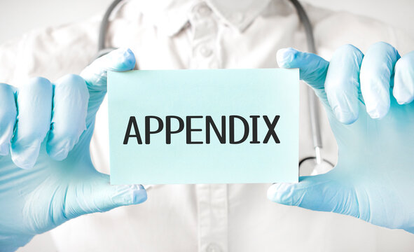 Doctor holding card in hands and pointing the word APPENDIX