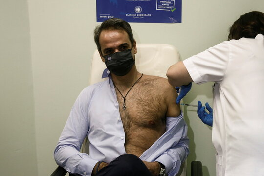 Greek PM Mitsotakis receives the second dose of a vaccine against coronavirus disease (COVID-19)