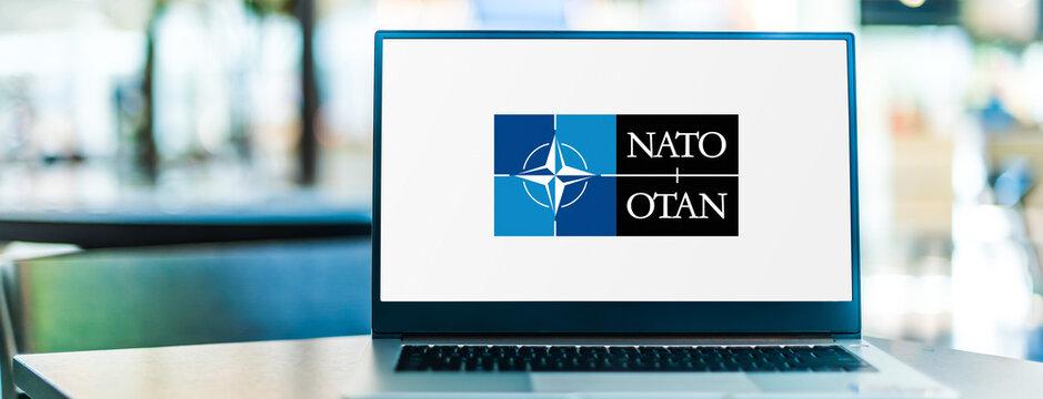 Laptop computer displaying logo of NATO