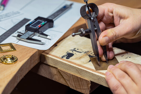 Custom jewelry making and drawing on a piece of metal.