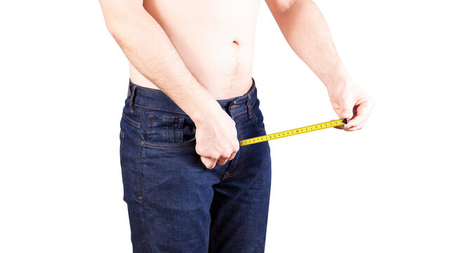 Penis size measure concept. Man measures his penis in pants. Erectile and potency concept.