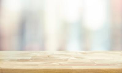 Obraz Wood table top on blur window glass,wall background - fototapety do salonu