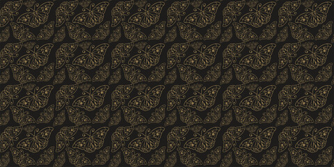 Decorative background pattern. Ornament with gold butterflies on a black background. Seamless wallpaper texture