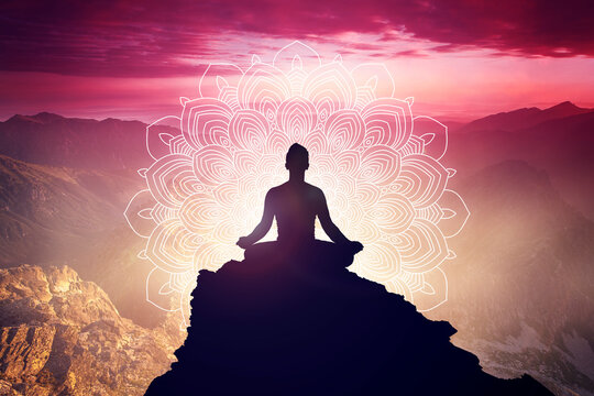 Meditation in yoga lotus position with mandala. Mindfulness and self awereness practice. Silhiuette of meditating person on beautifull landscape.
