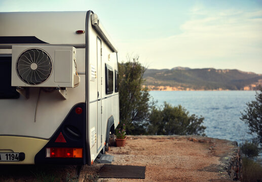 caravan is stand on camping place by sea bay