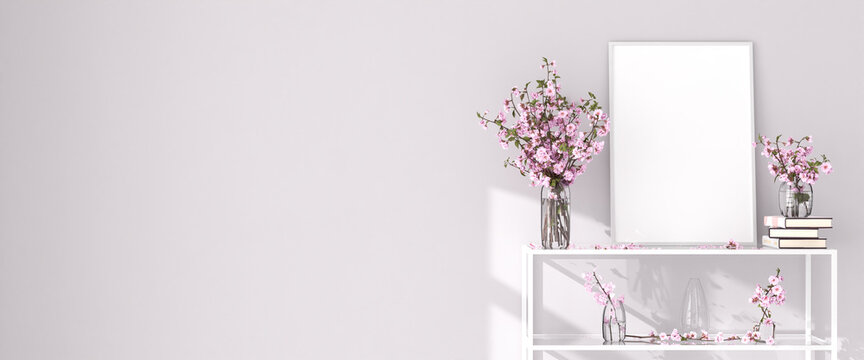 Mockup picture frame on a shelf in a living room. Cherry flowers in glass vases and  books. 3d render. Web banner format