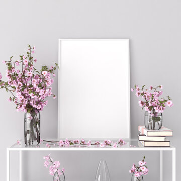 Mockup picture frame on a shelf in a living room. Cherry flowers in glass vases and  books. 3d render