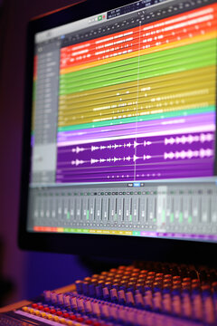 Close up of a DAW audio software arrangement being edited live in a professional recording studio.