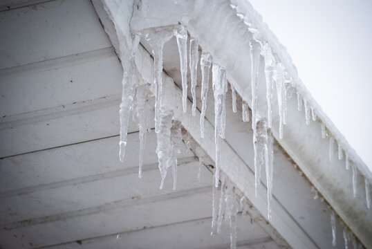icicles dripping from roof gutter