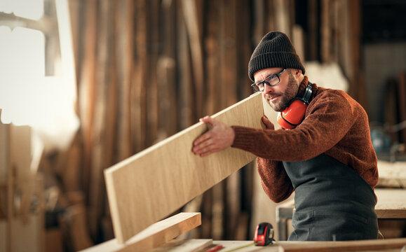 brutal male carpenter working in  workshop