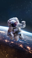 Astronaut on orbit of Earth in the outer space. Abstract wallpaper. Spaceman near surface of planet. Elements of this image furnished by NASA