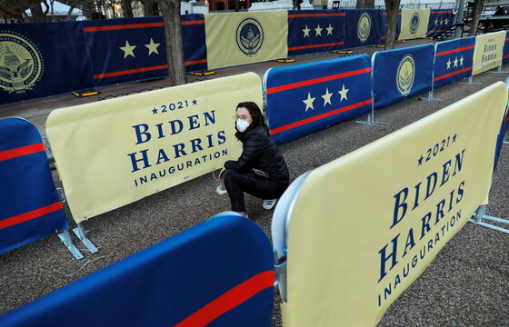 A volunteer sets up preparations for U.S. President-elect Joe Biden's inauguration, in Washington