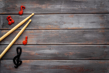 Drum sticks with music notes, overhead view. Music background
