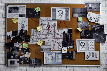 Detective board with fingerprints, photos, map and clues connected by red string on white brick wall - fototapety na wymiar