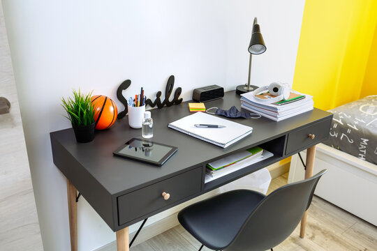 Youth bedroom interior with teenager desk
