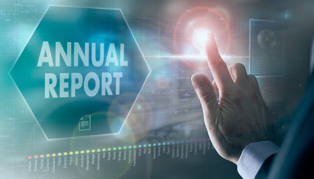 A businessman controlling a futuristic display with a Annual Report business concept on it.