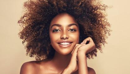 Fototapeta Beauty portrait of african american woman with clean healthy skin on beige background. Smiling beautiful afro girl.Curly black hair. Black teen girl obraz