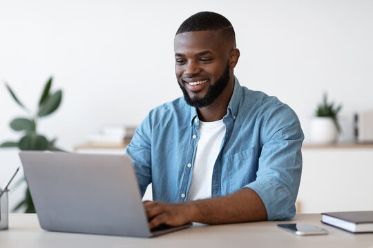 Remote Work. Handsome Black Freelancer Guy Working On Laptop At Home Office