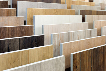 Obraz Laminate background. Samples of laminate or parquet with a pattern and wood texture for flooring and interior design. Production of wooden floors.. - fototapety do salonu