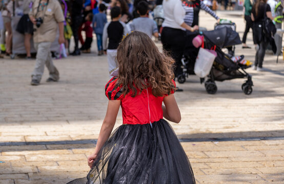 Undefined little girl celebrate the Purim holiday at a street event