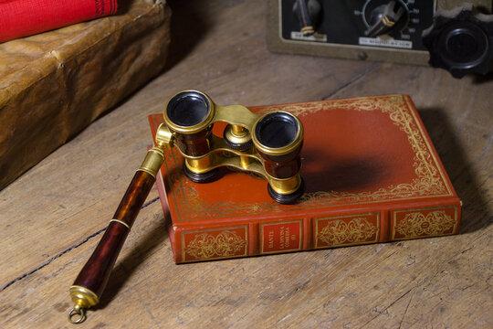 Theater binoculars and book