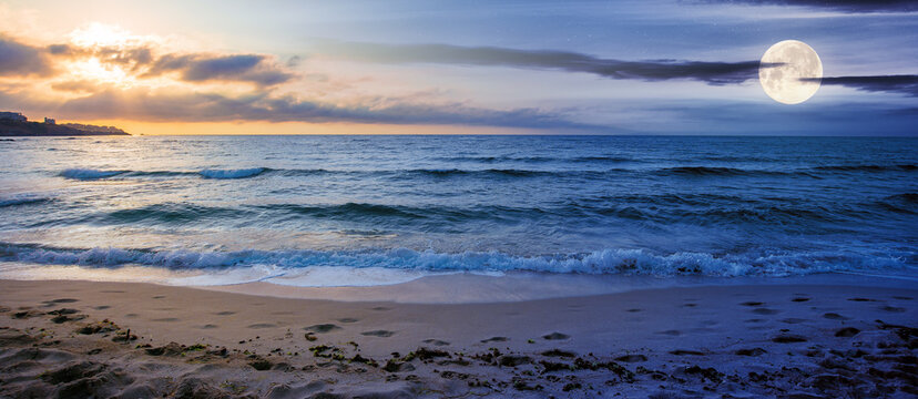 day and night time change concept at the seaside in summer. beautiful seascape with sun and moon. calm waves wash the golden sandy beach. fluffy clouds on the sky