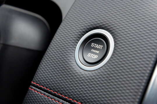 Engine start stop button in modern car close