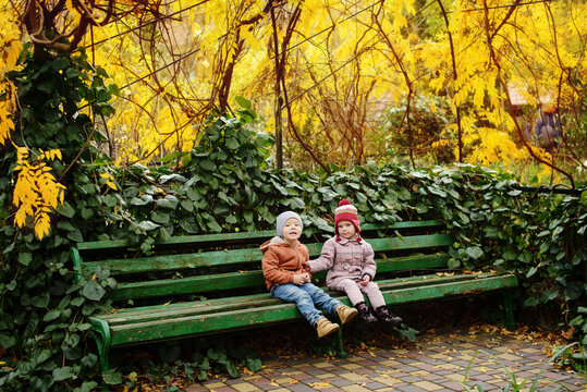 Two happy kids  on the bench