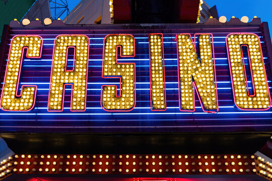 Close up shot of a Casino text neon sign