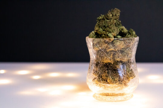 Cannabis in a cracked glass vase