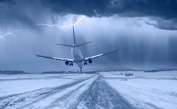 White passenger airplane landing on snowy airport - Oslo, Norway