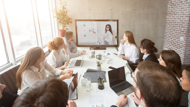Business Team Having Online Meeting In Office, Making Video Call