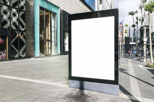 Blank white advertising banner on city street, mock up