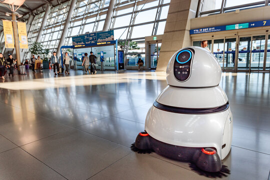 The airport cleaning robot in main hall of Incheon airport.