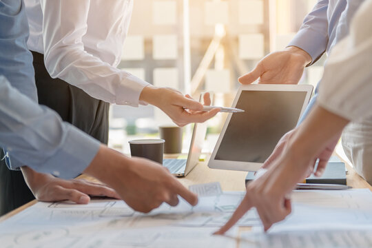 Businessman making presentation with his colleagues and business strategy digital layer effect at the office as concept.