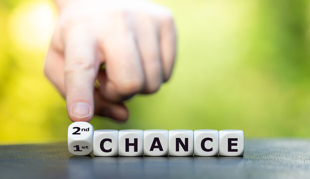 "Hand turns dice and changes the expression ""1st chance"" to ""2nd chance""."