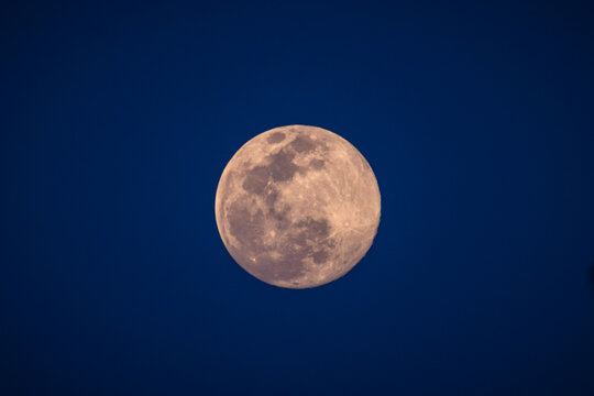 A supermoon is a full moon that nearly coincides with perigee, the closest that the Moon comes to the Earth in its elliptic orbit resulting in a slightly larger-than-usual apparent size of lunar disk.