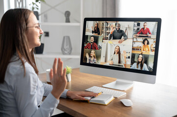 Webinars, online conference, video meeting. A businesswoman is using app on PC for video connect...