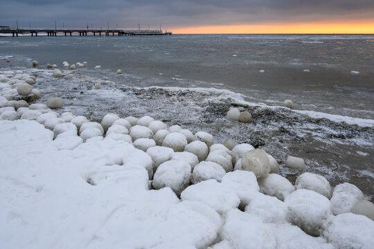 Natural ice balls on the beach in Jastarnia during winter. Hel Peninsula, Poland