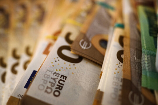 Bundled euro banknotes with selective focus