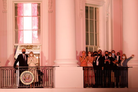 President Biden and First Lady Dr. Jill Biden watch a fireworks from the White House in Washington