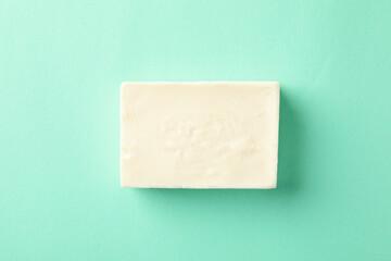 Obraz Piece of natural handmade soap on mint background - fototapety do salonu